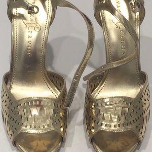 Gold stiletto pumps